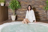 stock photo of hot-tub  - Young woman relaxing in the hot tub - JPG