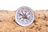 stock photo of orientation  - Orientation Concept Metal Compass on a Rock in the Desert