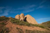 pic of wilder  - Rock boulders of stone emerge from a hillside in the wilderness of southern California - JPG