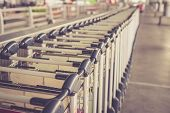 foto of trolley  - Close up trolleys luggage in a row in airport retro filter effect - JPG