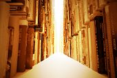 image of book-shelf  - Atmospheric image of long rows of books with blown light