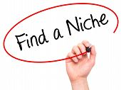 image of niche  - Man Hand writing Find a Niche with marker on transparent wipe board - JPG