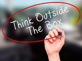 pic of thinking outside box  - Man Hand writing Think Outside The Box with marker on transparent wipe board - JPG