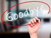 image of goodbye  - Man Hand writing Goodbye with marker on transparent wipe board - JPG