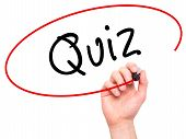 foto of quiz  - Man Hand writing Quiz with marker on transparent wipe board - JPG