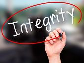 picture of integrity  - Man Hand writing Integrity black marker on visual screen - JPG