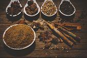 stock photo of garam masala  - Garam Masala with various seasonings for cooking on white spoons - JPG
