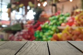 pic of fruits  - Defocus and blur image of terrace wood and Supermarket blur background in Fruits and Vegetables devision for background usage - JPG