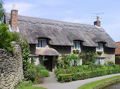 English thatched cottage at Thornton Dale, Yorkshire, England, UK.