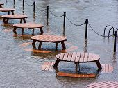 River Ouse bursts its banks flooding outdoor picnic area.