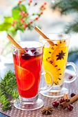 Orange and cranberry  punch with orange slices and spices.Hot drinks for winter and Christmas