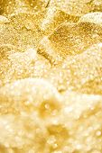 pic of gold glitter  - golden glitter sparkles background with shallow depth of field - JPG