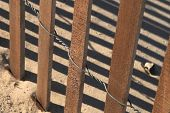 Snow Fence On Sand