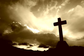 picture of christian cross  - cross detail in silhouette and the clouds in the sky - JPG