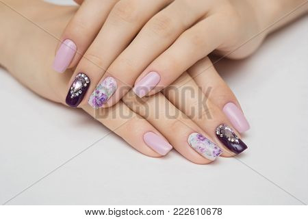 poster of Manicured nails Nail Polish art design. Violet with green colors Art Manicure. Nail Polish. Beauty hands. Fashion Stylish Trendy Colorful Nails