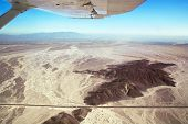 Nazca Lines Airplane Over Desert