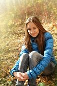 picture of teenage girl  - Portrait of a happy teen girl in autumn forest - JPG