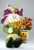 Skarecrow With Flowers In A Halloween Cup