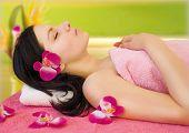 young woman enjoying bodycare