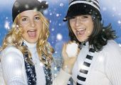 Two girls having fun in the snow. keyword for this collection is: snowmakers77