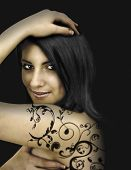 alluring woman with black ornament-tattoo
