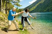 lovely mature couple hiking beside a lake