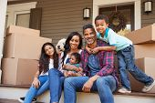 Family With Children And Pet Dog Outside House On Moving Day poster