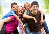 stock photo of family fun  - a cute family in the nature - JPG