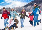 stock photo of snowball-fight  - cute family having fun in the snow - JPG