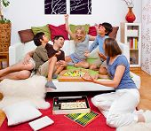 stock photo of indoor games  - a young family is playing board - JPG