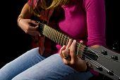 Girl Playing An Electric Guitar