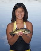 Girl Holding A Fish