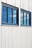 White Facade And Sky Reflexion