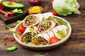 Burritos Wraps With Beef And Vegetables On A Wooden Background. Beef Burrito , Mexican Food. Healthy poster