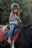 Baby Riding Girl