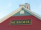 image of school building  - Colonial House School Building Against Blue Sky
