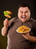Breakfast for overweight person.e of fat man eating fast food hamberger. Happy smile overweight pers poster