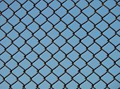 stock photo of stockade  - section of a chain link fence - JPG