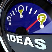 A vehicle fuel gauge with the word Ideas and needle pointing to a full light bulb symbol, representi