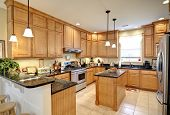 beautiful upscale kitchen with maple cabinets