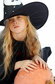 stock photo of jack-o-laterns-jack-o-latern  - Young blond girl dresses in hallowwen witch costume - JPG