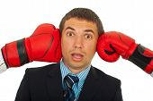 Surprised Man Between Boxing Gloves