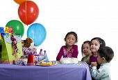 stock photo of birthday party  - The excitement of a birthday party childhood youth sharing friends - JPG