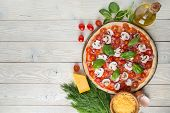 Pizza On The Stone For Baking Pizza And Ingredients Of Pizza On A Wooden Background Top View poster