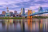Cincinnati, Ohio, USA downtown skyline and bridge on the river at dusk. poster