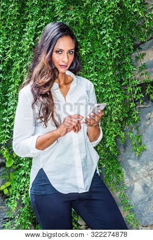 poster of Young Beautiful East Indian American Woman With Long Hair Traveling In New York City, Wearing White