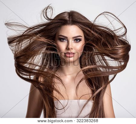 poster of Portrait of a beautiful woman with a long hair. Young  brunette model with  beautiful hair - isolate