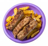 Grilled Pork Ribs With French Fries On A Purple Plate. Pork Ribs With French Fries On A White Backgr poster