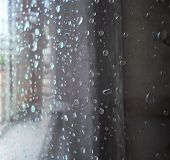 Raindrops On A Window Pane. Drops Of Water On A Metal Surface, On A Window Pane, Window In A House I poster