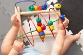 Baby Playing With Educational Toy In Nursery. Learning Colorful Wooden Toy.developing Toy. The Labyr poster